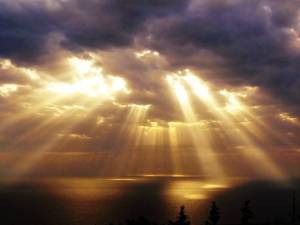 sun rays through the clouds image