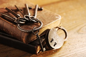 Old keys on a old book, antique wood background