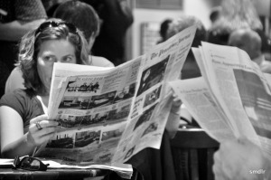lady with newspaper image