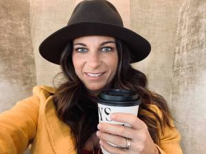 Emily with hat and coffee